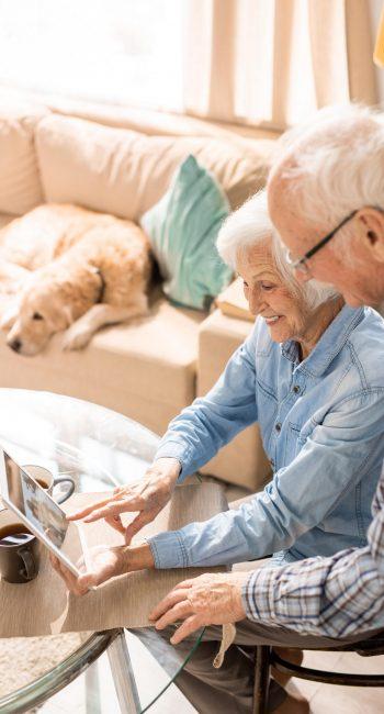 elderly-couple-using-digital-tablet-MVZEFPY-min